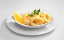 Calamari con el limón Imágenes de archivo libres de regalías