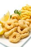 Calamari fried and potatoes. A dish with calamari fried and potatoes Royalty Free Stock Photos
