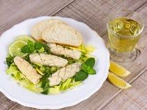 Calamari with green salad, lemon and mint Royalty Free Stock Image