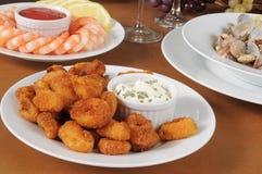 Calamari impanato con salsa più acida Fotografia Stock