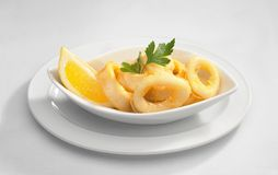 Calamari with lemon Royalty Free Stock Images