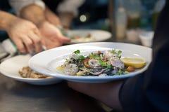 Calamari and pasta dish in restaurant royalty free stock image