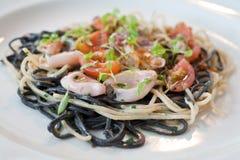 Calamari and pasta dish in restaurant stock images