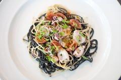 Calamari and pasta dish in restaurant stock photo