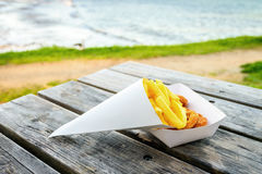 Calamari rings with chips on the table Stock Photography