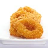 Calamari rings. Deep fried calamari rings on white Stock Images
