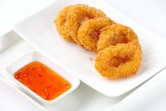 Calamari rings. Deep fried calamari rings on white Royalty Free Stock Photography