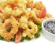 Calamari rings with soya sauce Stock Photography