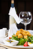 Calamari salad served with wine Royalty Free Stock Photo