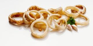 Calamari sautéed in garlic Stock Photos