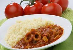 Calamari, squid food with cuoscous. Grain dish and tomato Stock Photo