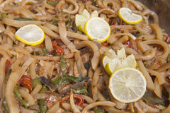 Calamari with vegetables at an oriental restaurant buffet royalty free stock photo