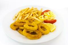 Calamaro fritto con le patate fritte Immagini Stock Libere da Diritti