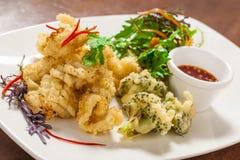 Calamaro fritto nel grasso bollente Fotografie Stock Libere da Diritti