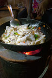 Calamaro tailandese della frittura di scalpore in un wok Fotografie Stock