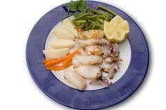 Calamary mit potatos Stockfotos