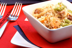 Calamary rice. Delicious calamary rice with assorted seafood and vegetables served on nice fancy table Royalty Free Stock Images