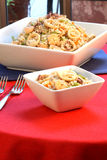 Calamary rice. Delicious calamary rice with assorted seafood and vegetables served on nice fancy table Stock Photo
