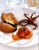 Calamary,zucchini and cherry tomato Tempuras Royalty Free Stock Image