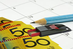 Calander money pencil Royalty Free Stock Image