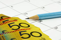 Calander pencil money Royalty Free Stock Image
