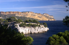 Calanque and cap Canaille. Calanque chez Cassis with cap Canaille in the background and the Mediterranean Royalty Free Stock Image