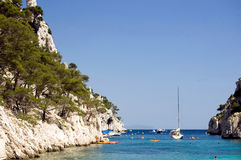 Calanques d'En-Vau. The bay Calanques d'En-Vau with swimmers and sailboats in the summer Royalty Free Stock Photos