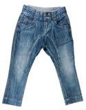 Calças azuis da sarja de Nimes Fotos de Stock