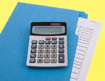 Calc and Folder. Calculator and blue folder for budget notes Stock Images