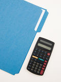 Calc and Folder. Calculator and blue folder for budget notes Royalty Free Stock Photo