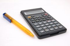 Calc & pen. Calc and pen islated on Royalty Free Stock Image