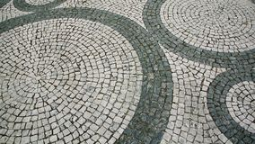 Calcada stone pavement in portugal Stock Photos