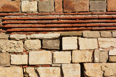 Calcareous stones and red bricks texture Stock Images