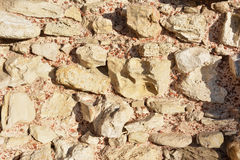 Calcareous stones and red bricks texture Royalty Free Stock Photos