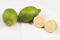 Calce verde dei limoni Fotografie Stock