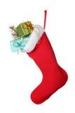 Calcetín de la Navidad con los regalos Imagen de archivo