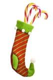 Calcetín de la Navidad con los regalos fotos de archivo