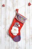 Calcetín de la Navidad en fondo de madera Imágenes de archivo libres de regalías