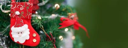 Calcetín de la Navidad Un calcetín rojo de la Navidad para los wi de la decoración de la Navidad foto de archivo libre de regalías