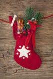 Calcetín rojo con el chocolate Krampus imágenes de archivo libres de regalías