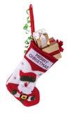 Calcetín y regalos de la Navidad Fotos de archivo