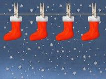 Calcetines rojos colgantes Fotos de archivo libres de regalías