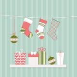 Calcetines y regalos de la Navidad Fotos de archivo