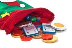 Calcetín con el dinero del chocolate Imágenes de archivo libres de regalías