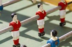 Calciatore rosso in giocattolo Fotografia Stock