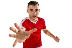 Calcio aggressivo e minaccioso o giocatore di football americano fotografia stock libera da diritti