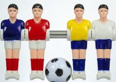 Calcio-balilla dei giocatori di football americano immagine stock