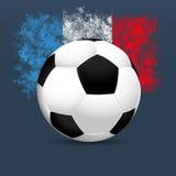Calcio 2016 della Francia Pallone da calcio su un fondo blu Colori della bandiera del francese Vettore Fotografie Stock