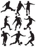 calcio della siluetta dei giocatori Fotografia Stock Libera da Diritti