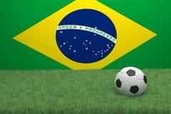 Calcio in Front Of The Flag Of Brasile Fotografia Stock Libera da Diritti